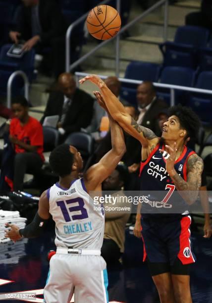 Capital City GoGo forward Devin Robinson blocks a shot attempt made by Greensboro Swarm guard Joe Chealey during an NBA G League match between the...