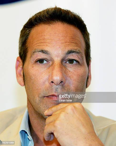 """Capital Entertainment president Henry Winterstern listens during a news conference announcing the release of three DVD compilations of the """"American..."""