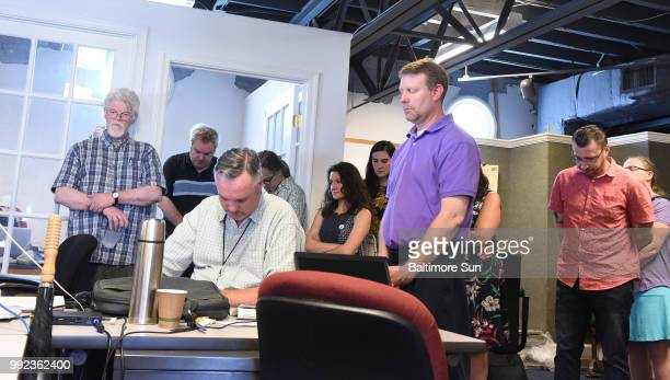 Capital Gazette employees pause for a moment of silence at 233 pm to commemorate their fallen coworkers on Thursday July 5 2018