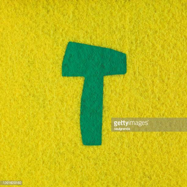 capital letter t painted on felt - letter t stock pictures, royalty-free photos & images
