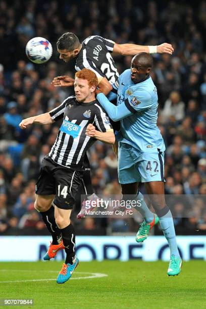 Capital One Cup Fourth Round Manchester City v Newcastle United Etihad Stadium Manchester City's Yaya Toure battles for the ball in the air with...