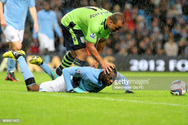 Capital One Cup Third Round Manchester City v Aston Villa Etihad Stadium Manchester City's Mario Balotelli takes a tumble after a challenge by Aston...