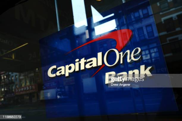 Capital One signage adorns a window of a Capital One bank in the Lower East Side of Manhattan on July 30 2019 in New York City In one of the...