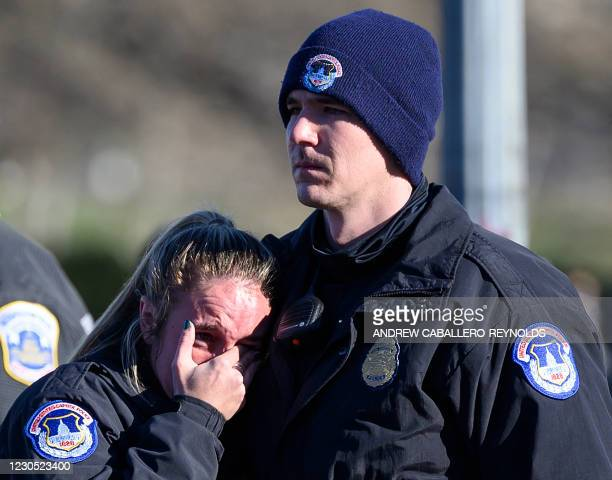Capital police react after the casket with fallen police officer, Brian Sicknick, passed during a funeral procession in Washington, DC on January 10,...