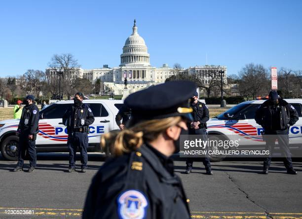 Capital police stand at attention before the casket with fallen police officer, Brian Sicknick, passes during a funeral procession in Washington, DC...
