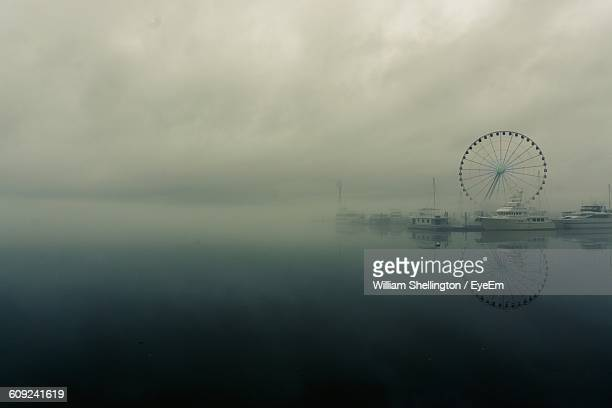 Capital Wheel On Harbor At Potomac River In Foggy Weather