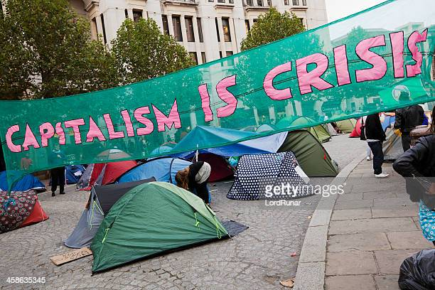 capitalism is crisis - capitalism stock pictures, royalty-free photos & images
