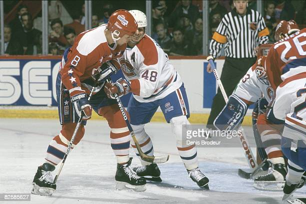 Capitals forward Dmitri Khristich and Canadiens defenceman JJ Daigneault jostle for position in front of goaltender Jocelyn Thibault while incoming...