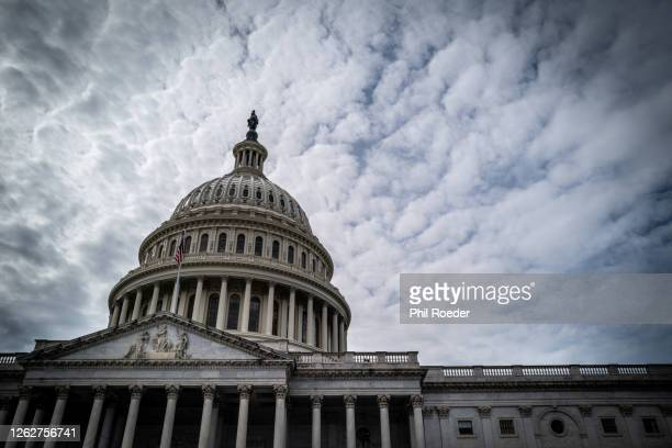 capitol and clouds - united states congress stock pictures, royalty-free photos & images
