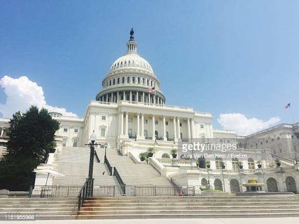 capitol building against sky in city - capital cities stock pictures, royalty-free photos & images