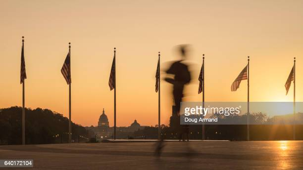 Capitol Building and Flags at sunrise