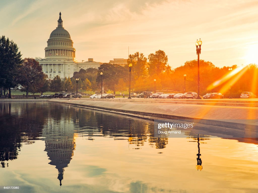 Capitol Building and Reflecting Pool in Washington D.C, USA at sunrise : Stock Photo
