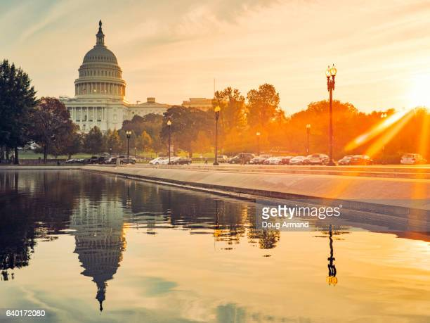 capitol building and reflecting pool in washington d.c, usa at sunrise - ワシントンdc ストックフォトと画像