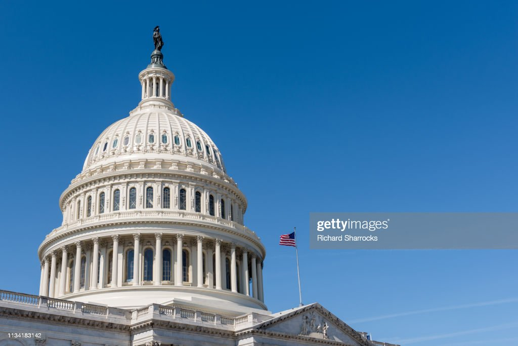 US Capitol building dome with American flag : Stock Photo