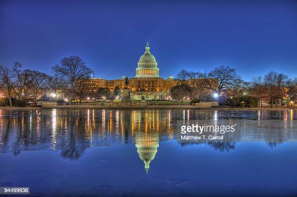 Capitol Building reflecting in lake