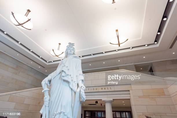 us capitol building visitor center interior, statue of freedom, washington dc - neo classical stock pictures, royalty-free photos & images