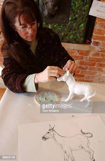 Capitol Hill artist Kris Swanson makes a glass mosiac on minature model of a donkey as part of a project by the DC Commision on the Arts and...