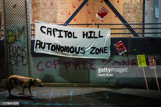 A Capitol Hill Autonomous Zone sign hangs on the exterior of the Seattle Police Departments East Precinct on June 9 2020 in Seattle Washington...