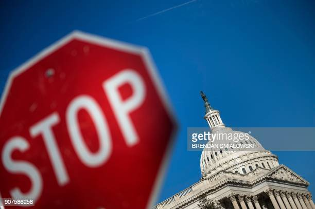 Capitol Hill is seen agains a blue sky while the government begins a shutdown January 20 2018 in Washington DC / AFP PHOTO / Brendan Smialowski