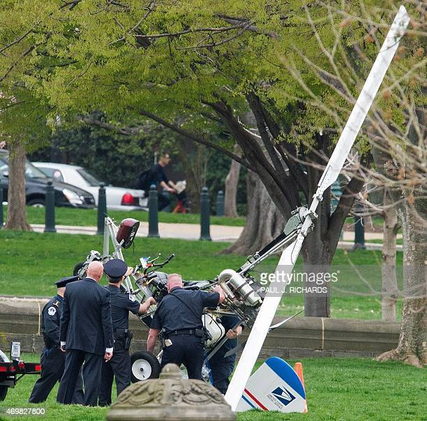 Capitol Hill police officers lift a gyrocopter that landed on the US Capitol South Lawn on to a trailer April 15 in Washington DC A man identified as...