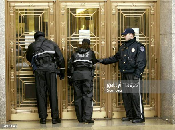 Capitol Hill Police stand near an entrance of the Dirksen Senate Office Building in Washington DC February 3 2004 US Senate offices closed today and...