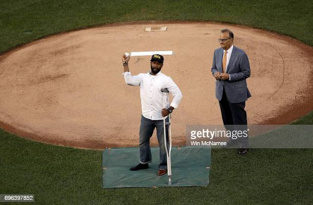 S Capitol Hill special agent David Bailey who was wounded in yesterday's shooting throws out the first pitch before the Congressional Baseball Game...