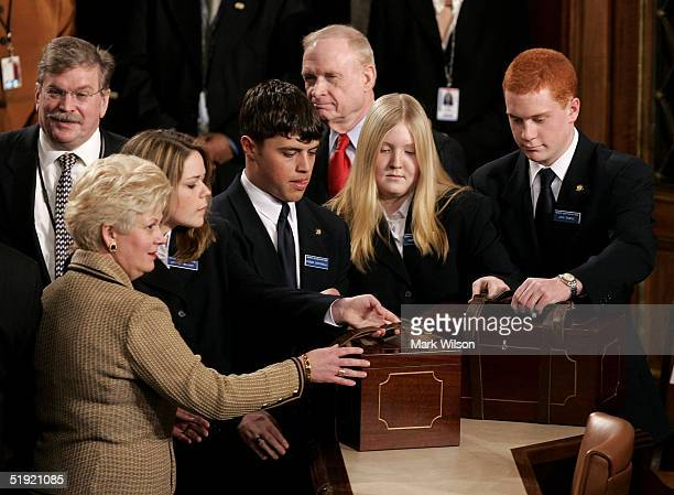 Capitol Hill staff members arrive with two brown boxes containing electoral votes during a joint session of Congress January 6, 2005 in Washington,...
