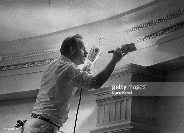 Capitol Paint Job Under Way; Harley Jackson, one of a crew of painters working on the $30,000 repainting job of the, Colorado Capitol, touches up a...