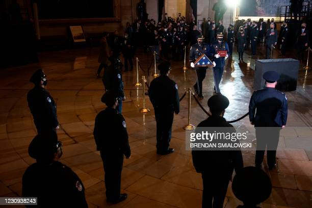 Capitol Police and lawmakers watch as the remains of Capitol Police officer Brian Sicknick arrive to lay in honor in the Rotunda of the US Capitol on...