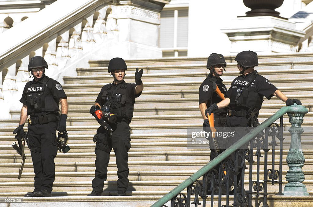 U.S. Capitol Police armed with pepper spray and tear gas launchers arrive guard the West Front of the Capitol during the anti-war protest on Saturday, Sept. 15, 2007.