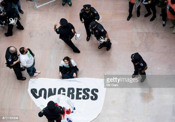 Capitol Police arrest a protesters who were holding a banner demanding a clean Dream Act in the Hart Senate Office Building on Thursday Nov 9 2017...