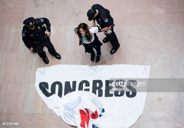 Capitol Police arrest a woman who was holding a banner demanding a clean Dream Act in the Hart Senate Office Building on Thursday Nov 9 2017...