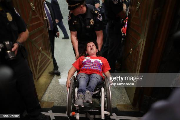 Capitol Police arrest protesters from handicap advocacy organizations as they shout and interrupt a Senate Finance Committee hearing about the...