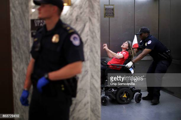 Capitol Police arrest protesters who shouted and interrupted a Senate Finance Committee hearing about the proposed Graham-Cassidy Healthcare Bill in...