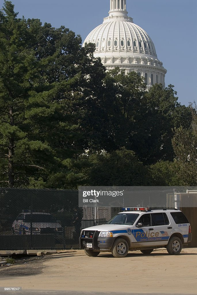 Capitol Police block the entrance leading to the Capitol Visitors Center site where a man drove his SUV through the gates leading to the construction site on the east side of the Capitol on Monday morning, Sept. 18, 2006. After the driver crashed his car into a fountain on the plaza, he ran into the Capitol building where he was arrested by police.