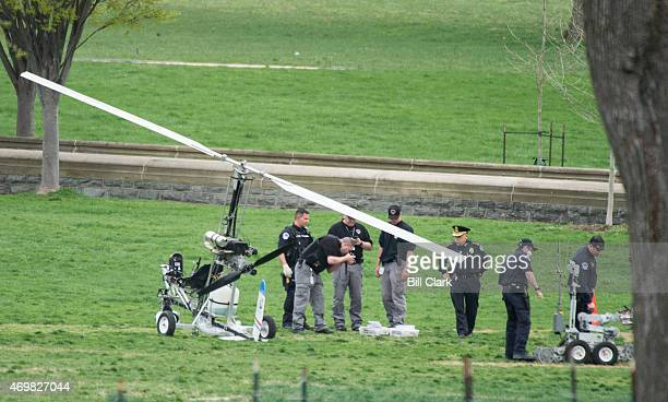 S Capitol Police Chief Kim Dine 3rd from right inspects the landing site of the gyrocopter on the West Lawn of the US Capitol on Wednesday April 15...