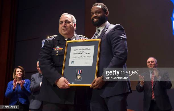 US Capitol Police Chief Matthew Verderosa presents US Capitol Police Special Agent David Bailey with the US Capitol Police Medal of Honor for his...