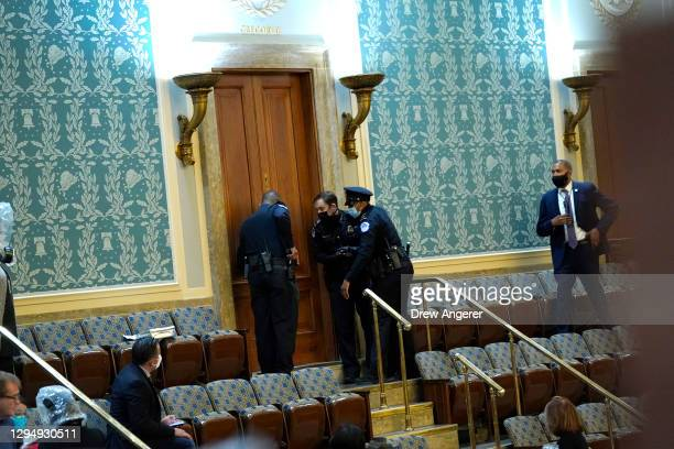 Capitol Police draw their guns as protesters attempt to enter the House Chamber during a joint session of Congress on January 06, 2021 in Washington,...