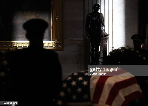 Capitol police honor guard stands next to the casket of the lateSen John McCain as he lies in state during a memorial service in his honor at the...