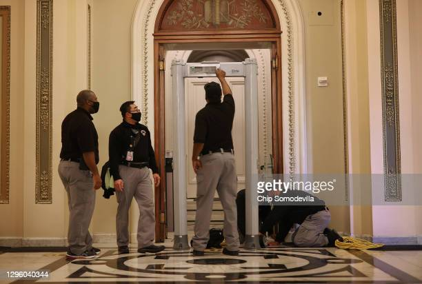 Capitol Police install a metal detector outside the House of Representatives Chamber, on the very spot where less than a week earlier violent...