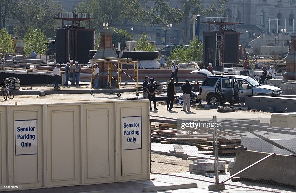 Capitol police investigate the scene where a man drove his SUV through the gates and into a fountain at the construction site of the Capitol Visitor's Center,Monday morning, Sept. 18, 2006. After the driver crashed his car into a fountain on the plaza, he ran into the Capitol building where he was arrested by police.
