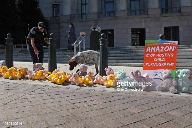 Capitol Police K9 dog inspects ParentsTogether's 'teddy bear sit in' in front of the Rayburn House Office Building July 29, 2020 in Washington, DC....