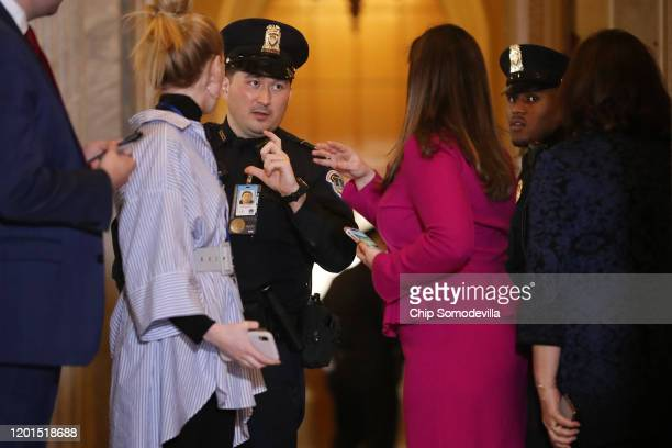 Capitol Police officer asks for identification from Rep. Elise Stefanik during a break in President Donald Trump's impeachment trial at the U.S....