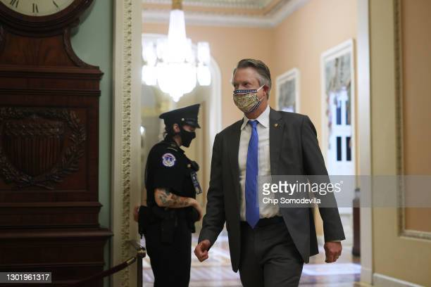 Capitol Police officer asks new Sen. Alex Padilla for his identification outside the Senate Chamber for the fifth day of former President Donald...