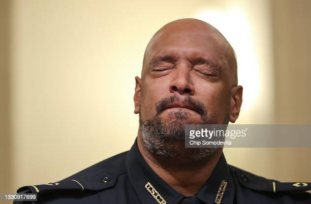 Capitol Police officer Harry Dunn becomes emotional as he testifies before the House Select Committee investigating the January 6 attack on the U.S....