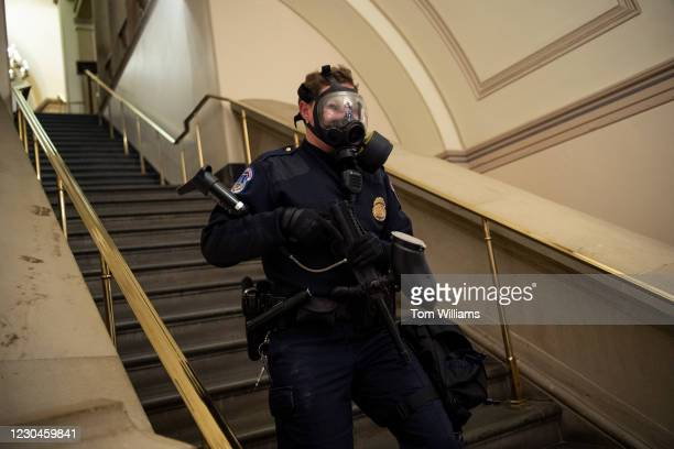 Capitol Police officer is seen as rioters try to break into the Capitol during a joint session of Congress to certify the Electoral College votes of...