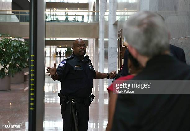Capitol Police Officer prevents people from entering the Hart Senate Office Building after the first floor was evacuated April 17, 2013 in...