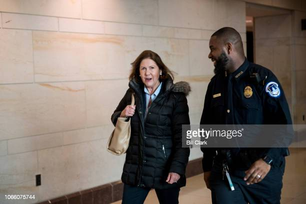 S Capitol Police officer shows Repelect Ann Kirkpatrick DAriz the way to the CVC Auditorium for the House Democrats' organizational caucus meeting on...