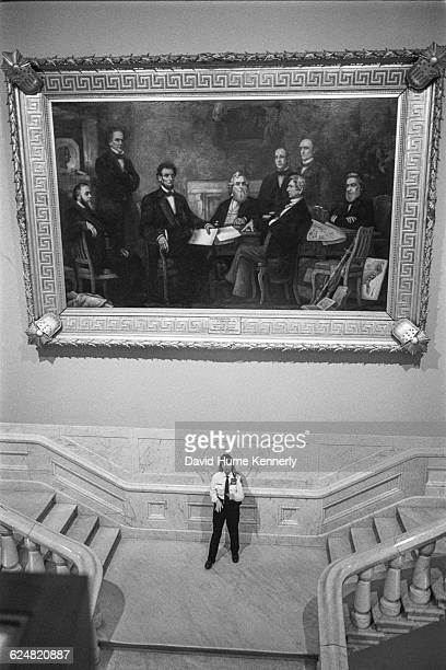 Capitol police officer stands beneath Francis Bicknell Carpenter's 1864 painting 'First Reading of the Emancipation Proclamation by President...