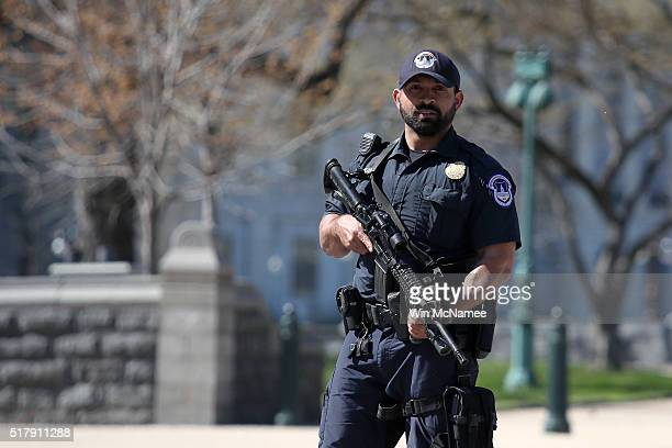 S Capitol Police officer stands guard during a lock down after shots were reportedly fired at the US Capitol Visitor Center March 28 2016 in...